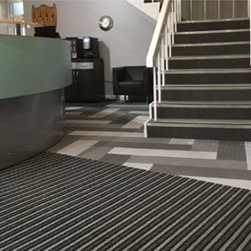 carpets next to staircase